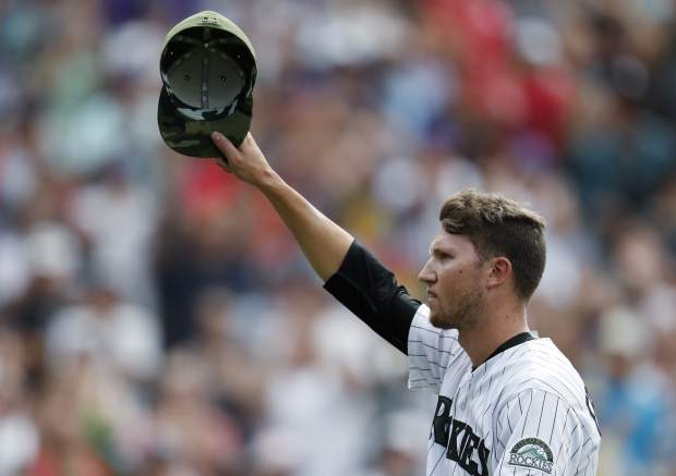 Colorado Rockies pitcher Kyle Freeland acknowledges the applause of the crowd as he heads to the dugout after being pulled from the mound when his no-hit bid was broken by a single off the bat of Chicago White Sox Melky Cabrera with one out in the ninth inning of a baseball game Sunday, July 9, 2017, in Denver. The Rockies won 10-0. (AP Photo/David Zalubowski)
