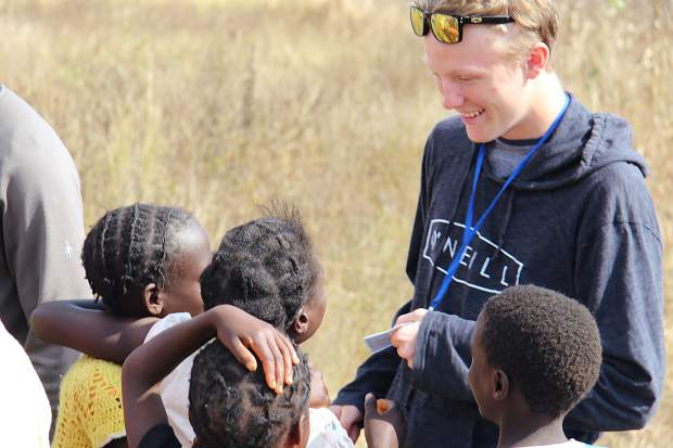 Ben Appleby, who will be a junior at Aspen High School, talks with the local Zambian children during a trip to the African nation in June. His parents, Alana and Blake, organize the Aspen Invitational bike ride, which raises money for bicycles to give to the people of Zambia.