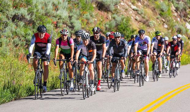 Professional cyclist Katie Compton helps lead a group of riders Saturday during the sixth annual Aspen Invitational bike ride around Aspen and Snowmass.