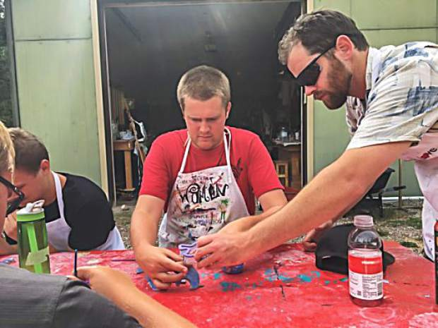Ascendigo Autism Services participants work with Scavenger Industries on mosaic tiles. During this weekend's Mountain Fair, the community will be invited to create more tiles. They'll become part of a bench installed on the Rio Grande ArtWay.