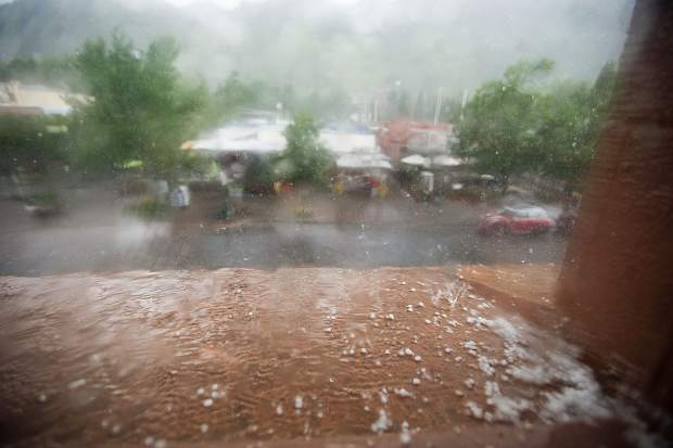 Hail sits on the ledge of the Wheeler Opera House in Aspen on Tuesday during a storm.