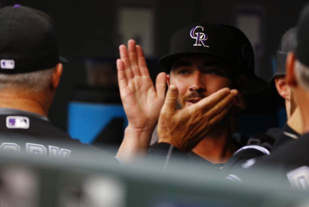 Colorado Rockies starting pitcher Chad Bettis high-fives teammates in the dugout before a baseball game against the Atlanta Braves, Monday, Aug. 14, 2017, in Denver. The game marks Bettis' first of the year after battling cancer. (AP Photo/Jack Dempsey)