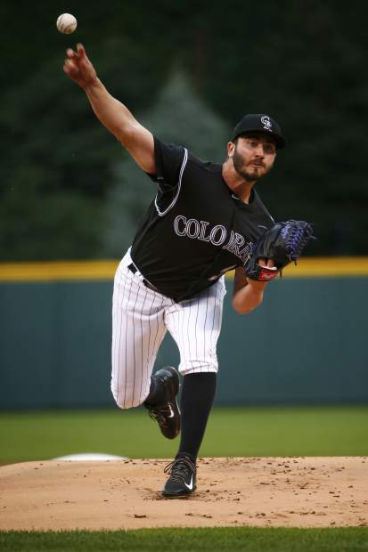 Colorado Rockies starting pitcher Chad Bettis throws to the plate during the first inning of a baseball game against the Atlanta Braves, Monday, Aug. 14, 2017, in Denver. (AP Photo/Jack Dempsey)