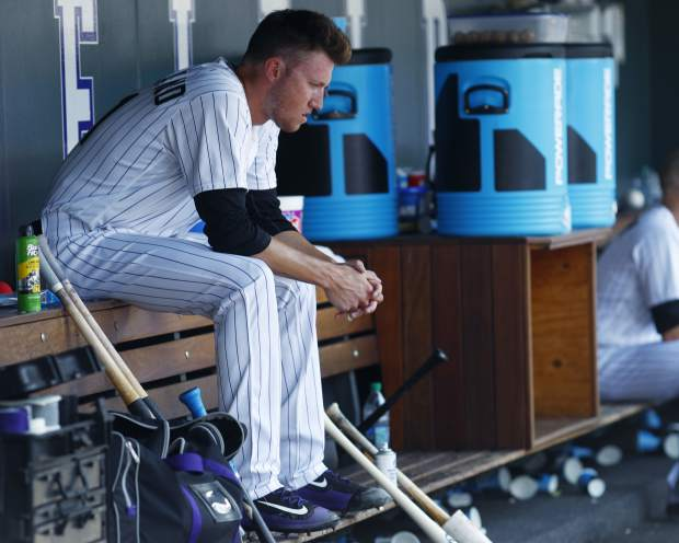 Colorado Rockies starting pitcher Kyle Freeland sits in the dugout after being pulled from the mound after walking Milwaukee Brewers' Orlando Arcia during the sixth inning of a baseball game Sunday, Aug. 20, 2017, in Denver. The Brewers won 8-4. (AP Photo/David Zalubowski)