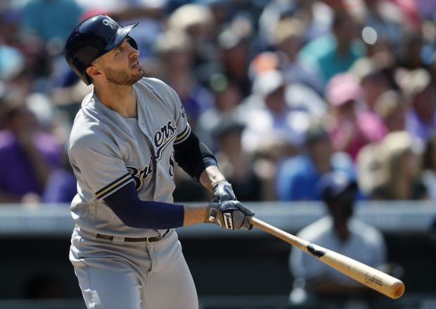 Milwaukee Brewers' Ryan Braun follows the flight of his sacrifice fly to drive in a run off Colorado Rockies starting pitcher Kyle Freeland in the fifth inning of a baseball game, Sunday, Aug. 20, 2017, in Denver. The Brewers won 8-4. (AP Photo/David Zalubowski)