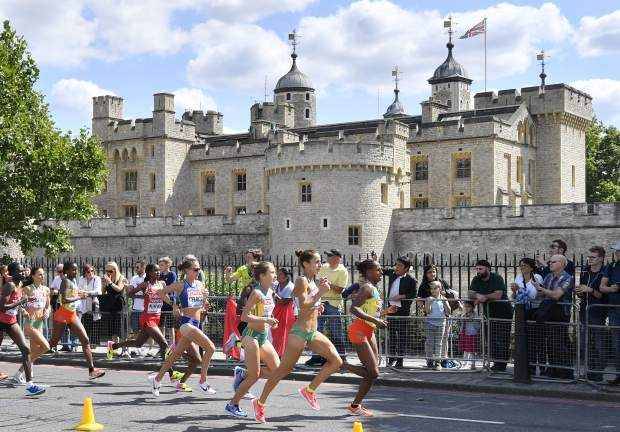 Ethiopia's Aselefech Mergia, Portugal's Catarina Ribeiro, Australia's Jessica Trengove and United States' Amy Cragg, from right, lead the pack of the women's marathon as they pass by the Tower of London during the World Athletics Championships in London Sunday, Aug. 6, 2017. (AP Photo/Martin Meissner)