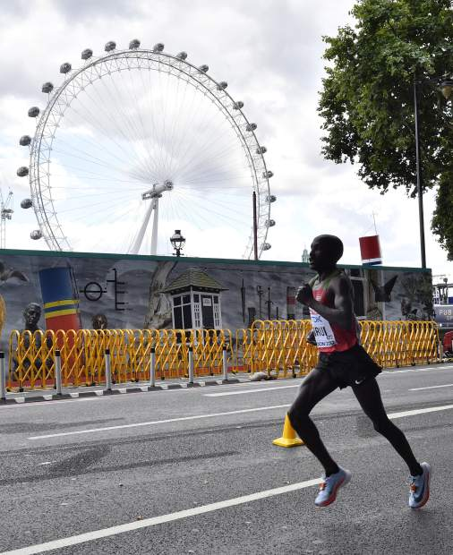Kenya's Geoffrey Kipkorir Kirui races past the London Eye on his way to winning the gold medal in the Men's Marathon during the World Athletics Championships Sunday, Aug. 6, 2017. (AP Photo/Martin Meissner)