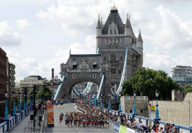 Competitors start from Tower Bridge in the Men's Marathon during the World Athletics Championships Sunday, Aug. 6, 2017. (AP Photo/Tim Ireland)