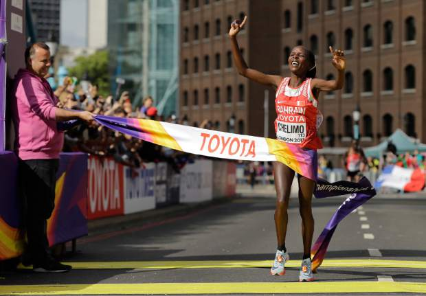Bahrain's Rose Chelimo celebrates after finishing in gold medal position in the Women's Marathon during the World Athletics Championships Sunday, Aug. 6, 2017. (AP Photo/Tim Ireland)