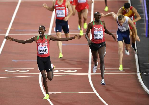 Kenya's Elijah Motonei Manangoi, left, celebrates as he crosses the finish line to win the Men's 1500 meters final at the World Athletics Championships in London Sunday, Aug. 13, 2017. (AP Photo/Martin Meissner)