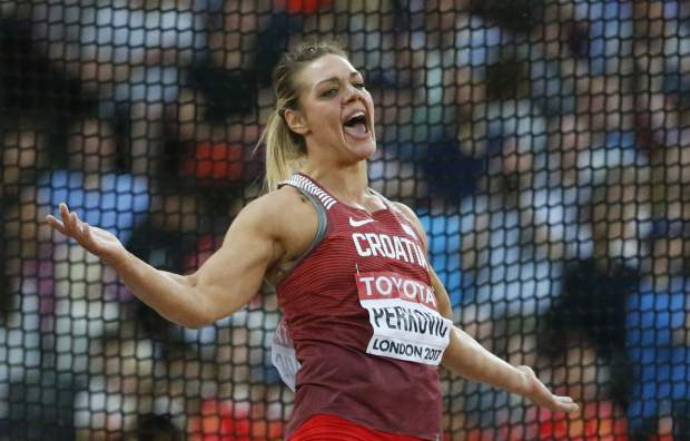 Croatia's Sandra Perkovic reacts after an attempt during the women's discus final during the World Athletics Championships in London Sunday, Aug. 13, 2017. (AP Photo/Matt Dunham)