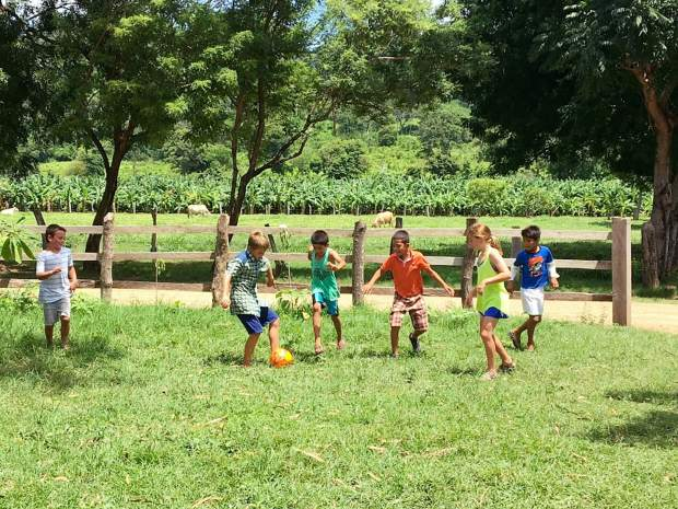 The Chacos children play with some of the youngsters in El Tambo, Nicaragua, before a chicken soup lunch. This is a tiny community that received electricity only three years ago.
