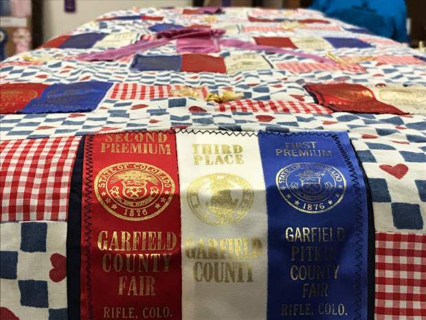 The quilt is made with ribbons Cathy Meskel won, spanning 10 years. Over those years, she won a total of 165 ribbons.