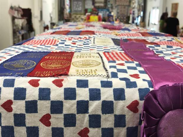 The quilt took Cathy Meskel three weeks to complete and serves to represent the years of friendly competition between her and Darleen Mackley.