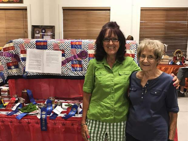 Cathy Meskel, left, stands with Darleen Mackley, to whom Meskel dedicated a quilt to honor their Garfield County Fair rivalry.