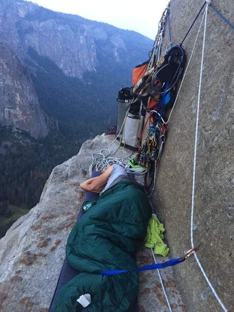 A multi-day rock climbing journey means sleeping on the side of the rock.
