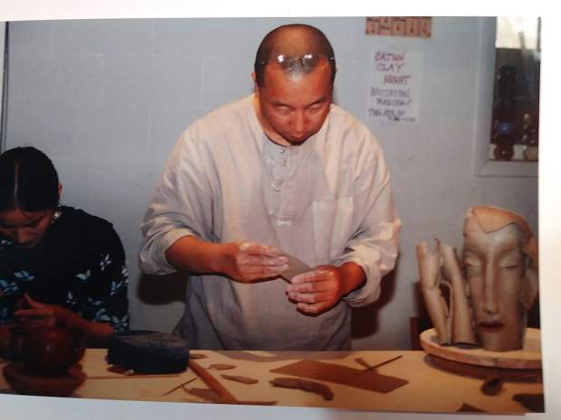 2002 Visiting Artist Yi Xing, shown with sculptural piece now in the Clay Center's permanent collection.