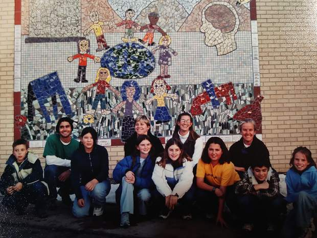2001: Chuck Malloy and resident artists Albion Stafford and Steven Colby construct the resident artist studios. Also in 2001, pictured: Resident artists Frank Saliani (in green T shirt) and Katrina Thernell (in glasses) worked with local kids to create and install this ceramic tile mosaic at the Third Street Center.