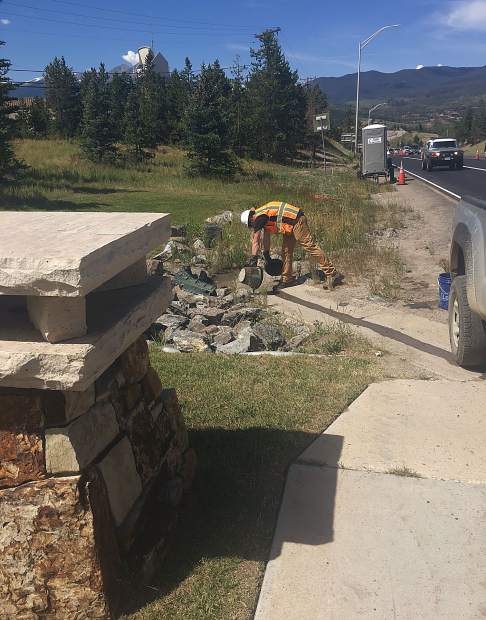 A worker for Kumar & Associates, subcontracted by Silverthorne-based Columbine Hills Concrete, Inc., dumps a bucket of prohibited materials directly into a Dillon drainage, as witnessed on July 19. The incident resulted in CDOT issuing a half-day stop work order to the State Highway 9-U.S. Highway 6 contractor APC Southern Construction the next morning.