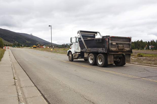 A nearby construction crew works away on Dillon Ridge Road in Dillon on Wednesday, July 26.