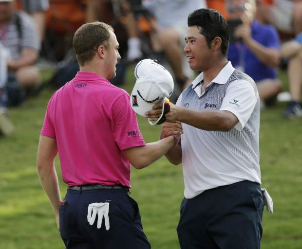 Justin Thomas, left, and Hideki Matsuyama of Japan, shake hands after final round of the PGA Championship golf tournament at the Quail Hollow Club Sunday, Aug. 13, 2017, in Charlotte, N.C. (AP Photo/Chuck Burton)