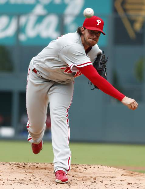 Philadelphia Phillies starting pitcher Aaron Nola delivers a pitch to Colorado Rockies' Gerardo Parra in the first inning of a baseball game, Sunday, Aug. 6, 2017, in Denver. (AP Photo/David Zalubowski)