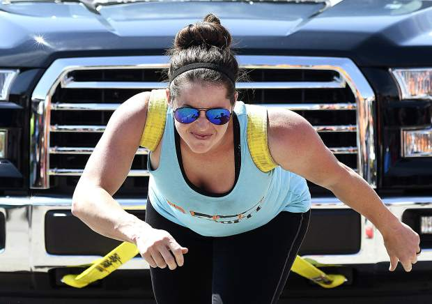 Ashton Bowen of Rifle eyes the finish line as she pulls the 7,000-pound full-size pickup Sunday.