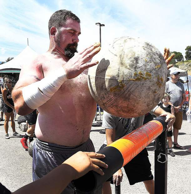 Jeremy Everding of Glenwood Springs tosses the 275-pound atlas stone over the bar with ease during the final event Sunday.