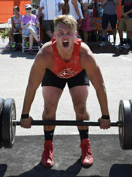 Jesse Duplesys of New Castle focuses all his energy in lifting 405 pounds in the deadlift portion of the Strongman Competiton Sunday in Rifle.
