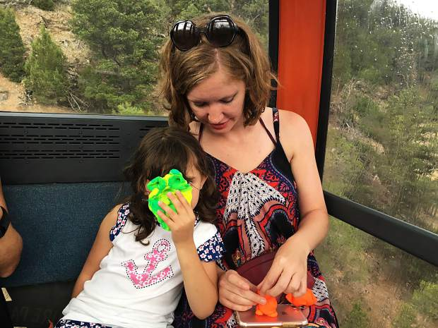 If you find yourself stuck in a small space with young children, hope you have their mother along. Play-doh saved the day during an Iron Mountain Tramway stoppage. Play distracted 4-year-old Isabella from the cabin's swaying motion.