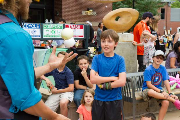 Cole Geiger, 12, challenges Salida Circus performer Jo Lobeck during a juggling game at the summer block party in downtown Glenwood Saturday evening.