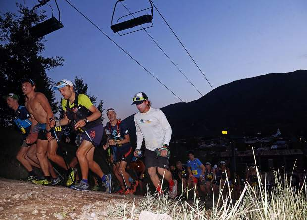 Racers begin their charge up Aspen Mountain early Sunday morning for the annual Audi Power of Four 50k run, which ended hours later in Snowmass Village. Morgan Elliott won the race for the second consecutive year.