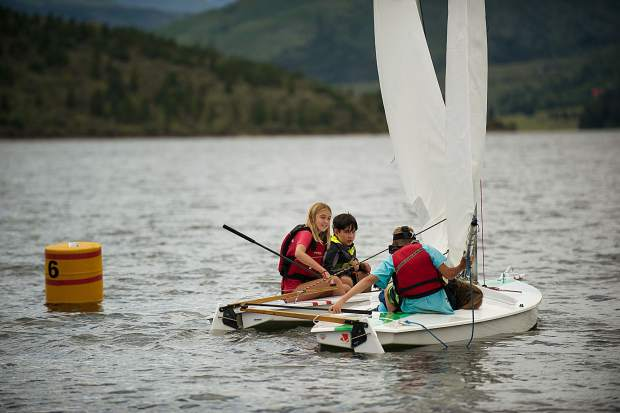 A close-call collision on Ruedi Reservoir between students particitpating in the Don Sheeley Sailing School on Tuesday.