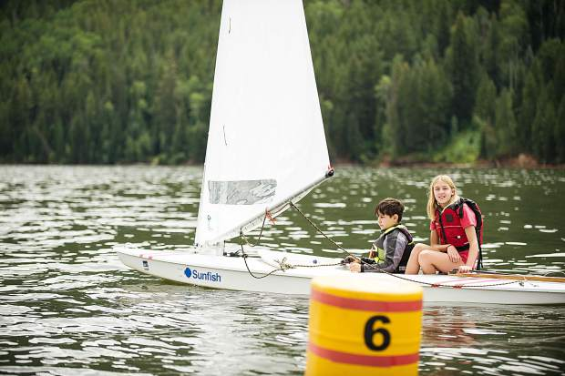 Hope White, 12, and Noah Incze, 10, racing their sunfish sailboat on Tuesday on Ruedi Reservoir.