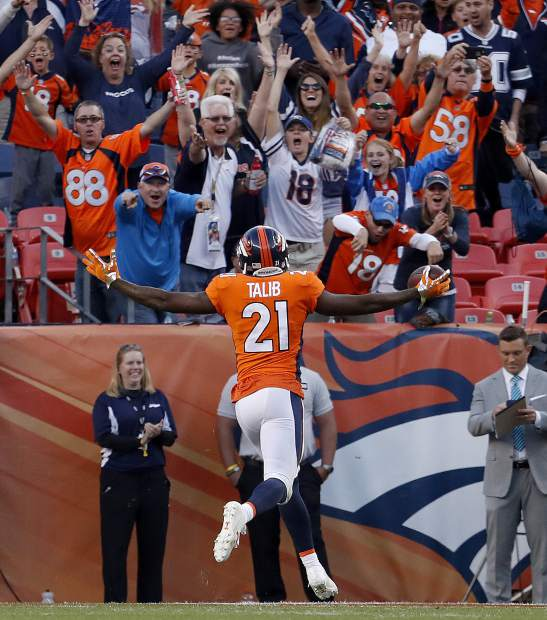 Denver Broncos cornerback Aqib Talib (21) runs back an interception against the Dallas Cowboys for a touchdown during the second half of an NFL football game, Sunday, Sept. 17, 2017, in Denver. (AP Photo/Joe Mahoney)