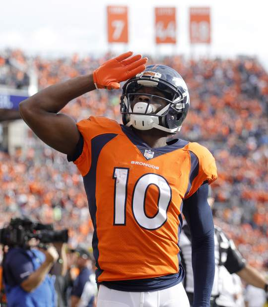 Denver Broncos wide receiver Emmanuel Sanders (10) celebrates his touchdown against the Dallas Cowboys during the first half of an NFL football game, Sunday, Sept. 17, 2017, in Denver. (AP Photo/Joe Mahoney)