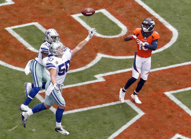 Denver Broncos wide receiver Emmanuel Sanders (10) pulls in a touchdown catch as Dallas Cowboys middle linebacker Sean Lee (50) and cornerback Chidobe Awuzie (33) defend during the first half of an NFL football game, Sunday, Sept. 17, 2017, in Denver. (AP Photo/Joe Mahoney)