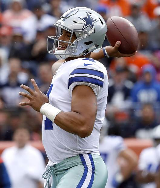 Dallas Cowboys quarterback Dak Prescott (4) throws against the Denver Broncos during the first half of an NFL football game, Sunday, Sept. 17, 2017, in Denver. (AP Photo/Jack Dempsey)