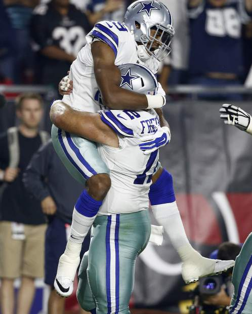 Dallas Cowboys wide receiver Brice Butler (19) celebrates his touchdown against the Arizona Cardinals with Dallas Cowboys center Travis Frederick (72) during the second half of an NFL football game, Monday, Sept. 25, 2017, in Glendale, Ariz. (AP Photo/Ross D. Franklin)