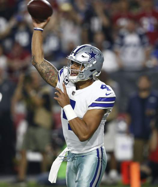 Dallas Cowboys quarterback Dak Prescott (4) throws against the Arizona Cardinals during the first half of an NFL football game, Monday, Sept. 25, 2017, in Glendale, Ariz. (AP Photo/Ross D. Franklin)