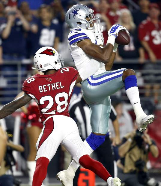 Dallas Cowboys wide receiver Brice Butler (19) pulls in a touchdown catch as Arizona Cardinals cornerback Justin Bethel (28) defends during the second half of an NFL football game, Monday, Sept. 25, 2017, in Glendale, Ariz. (AP Photo/Ross D. Franklin)