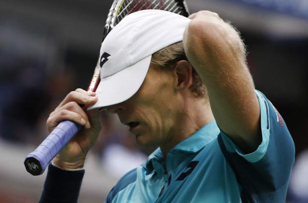 Kevin Anderson, of South Africa, adjusts his cap between serves from Rafael Nadal, of Spain, during the men's singles final of the U.S. Open tennis tournament, Sunday, Sept. 10, 2017, in New York. (AP Photo/Andres Kudacki)