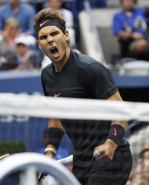 Rafael Nadal, of Spain, reacts after scoring a point against Kevin Anderson, of South Africa, during the men's singles final of the U.S. Open tennis tournament, Sunday, Sept. 10, 2017, in New York. (AP Photo/Julio Cortez)
