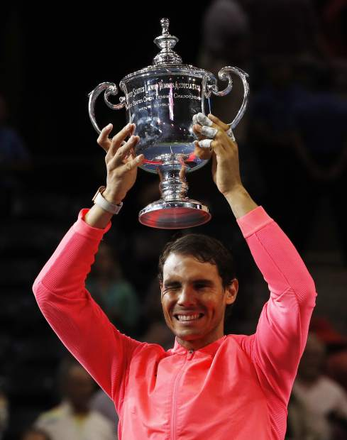 Rafael Nadal, of Spain, holds up the championship trophy after beating Kevin Anderson, of South Africa, in the men's singles final of the U.S. Open tennis tournament, Sunday, Sept. 10, 2017, in New York. (AP Photo/Andres Kudacki)