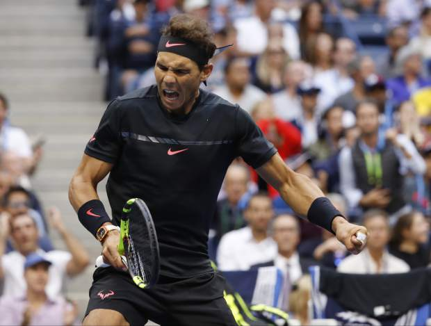 Rafael Nadal, of Spain, reacts after scoring a point against Kevin Anderson, of South Africa, during the men's singles final of the U.S. Open tennis tournament, Sunday, Sept. 10, 2017, in New York. (AP Photo/Adam Hunger)
