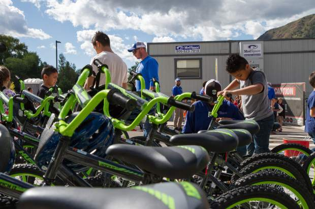 GSES second graders pick out their brand new bikes outside the school Friday morning.