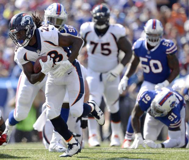 Denver Broncos running back Jamaal Charles (28) runs with the ball on his way to a touchdown against the Buffalo Bills during the first half of an NFL football game, Sunday, Sept. 24, 2017, in Orchard Park, N.Y. (AP Photo/Adrian Kraus)