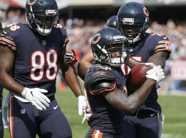 Chicago Bears running back Tarik Cohen, center, celebrates a touchdown with teammates during the second half of an NFL football game against the Atlanta Falcons, Sunday, Sept. 10, 2017, in Chicago. (AP Photo/Nam Y. Huh)