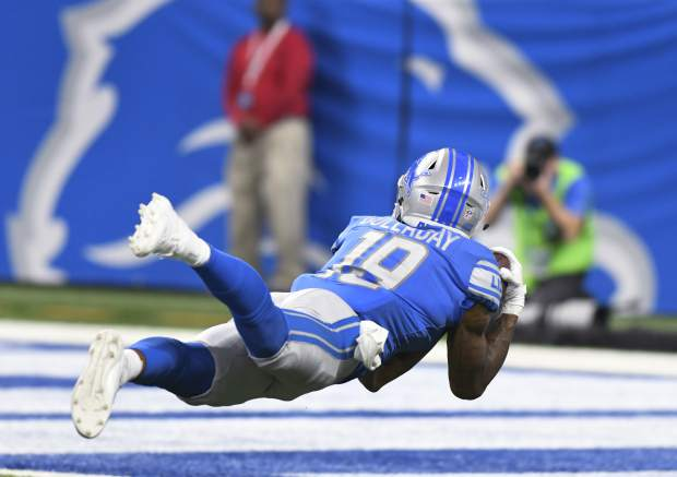 Detroit Lions wide receiver Kenny Golladay (19) catches a 45-yard touchdown reception against the Arizona Cardinals during the second half of an NFL football game in Detroit, Sunday, Sept. 10, 2017. (AP Photo/Jose Juarez)