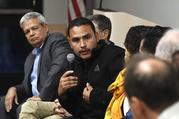 Junior Ortega of Rifle voices his and other members of the Latino community's concerns with the broken immigration system during Tuesday's forum in Glenwood.